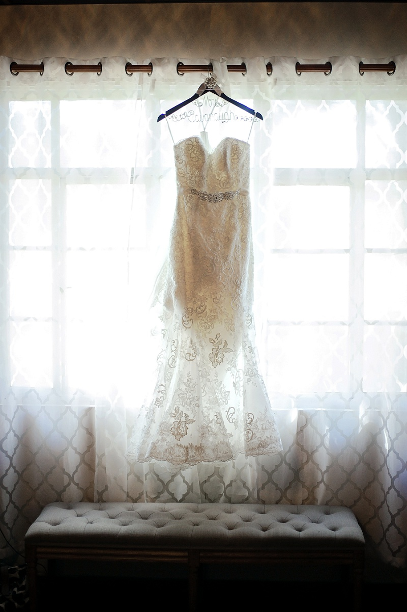 wedding dress hanging in window columbia ballroom