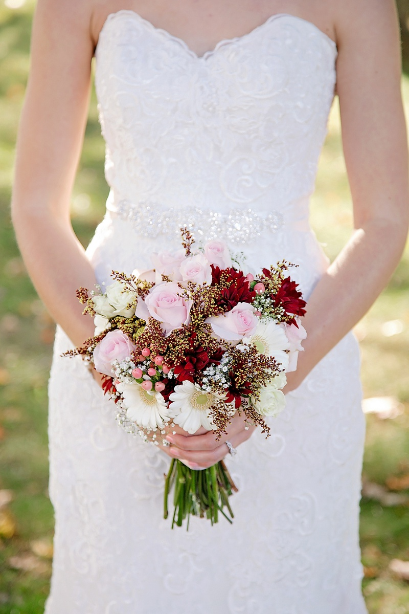bride holds bouquet