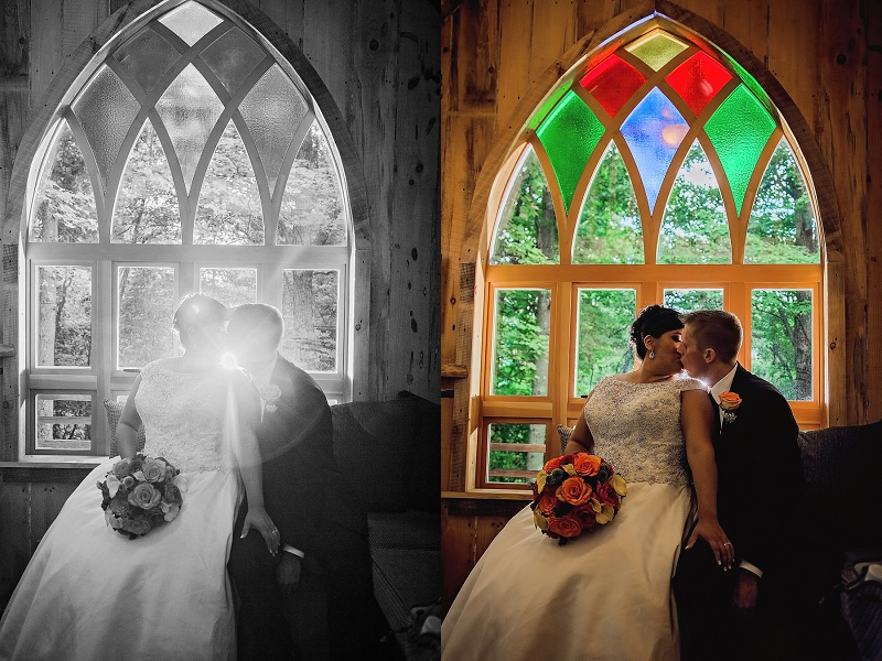 bride and groom in front of stained glass in treehouse