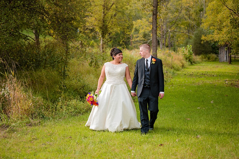 bride and groom take walk