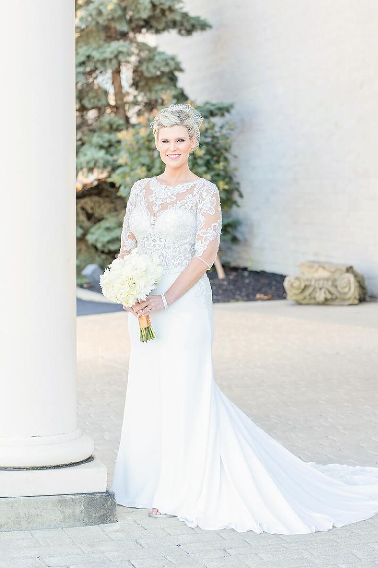 bride standing near column camden falls tiffin ohio wedding