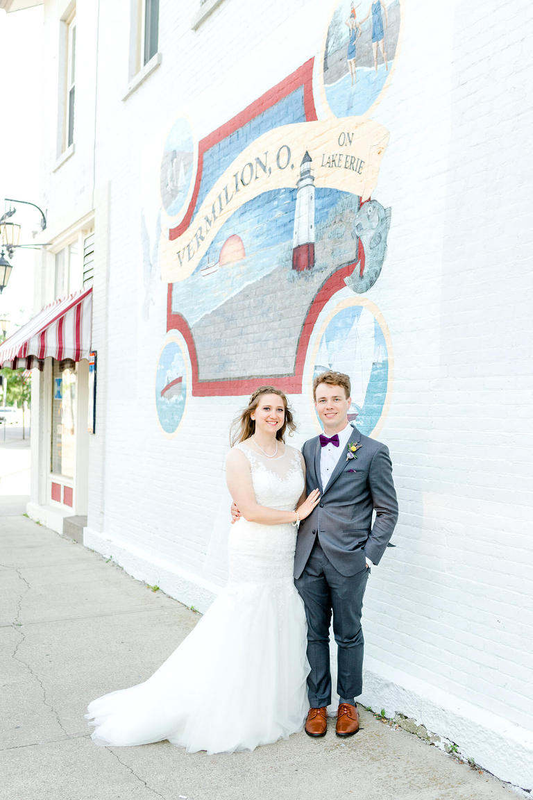 bride and groom portrait in front of vermilion mural downtown vermilion ohio photographer tiffany murray