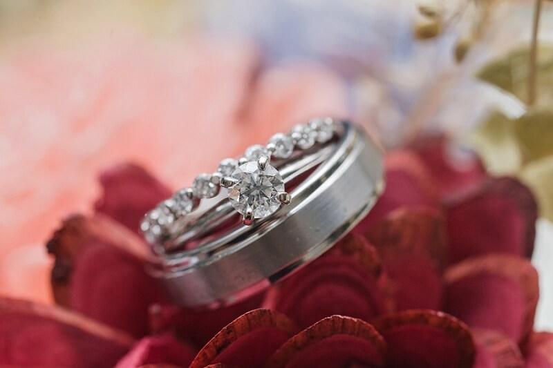bride and groom's rings on wooden flowers