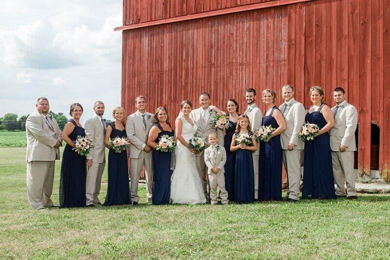 rustic wedding bridal party in front of barn willard ohio