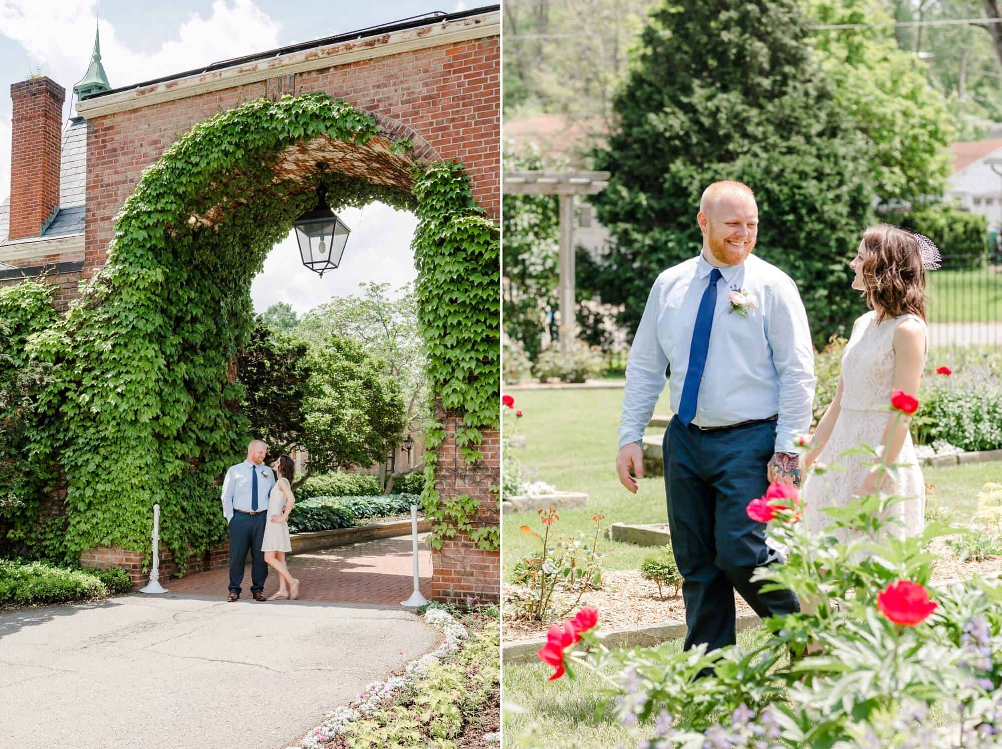bride and groom pose under ivy covered brick arch kingwood center gardens