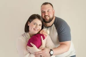 mom and dad posing with newborn mansfield ohio photographer