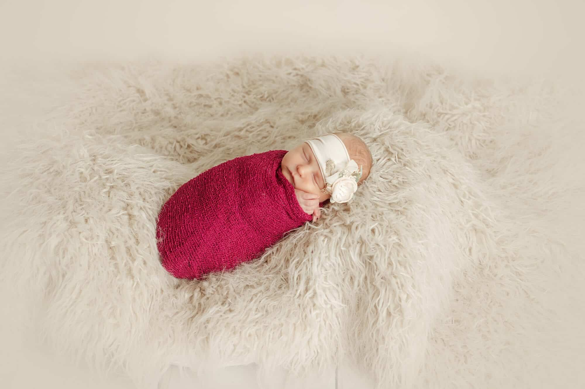 newborn girl on rug tiffany murray photography