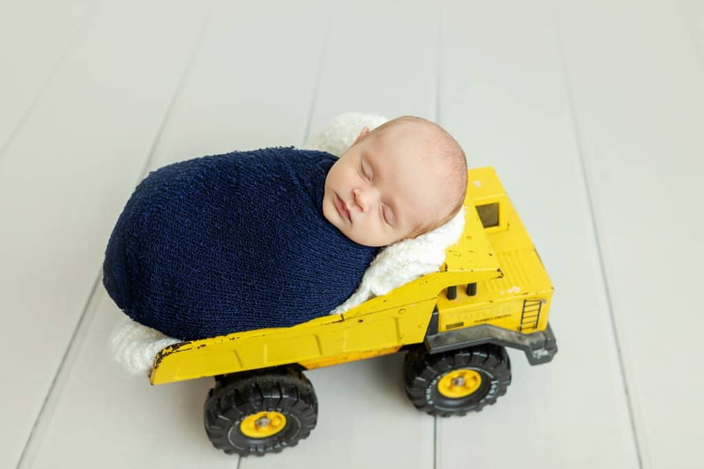 newborn boy in tonka truck newborn photoraphy