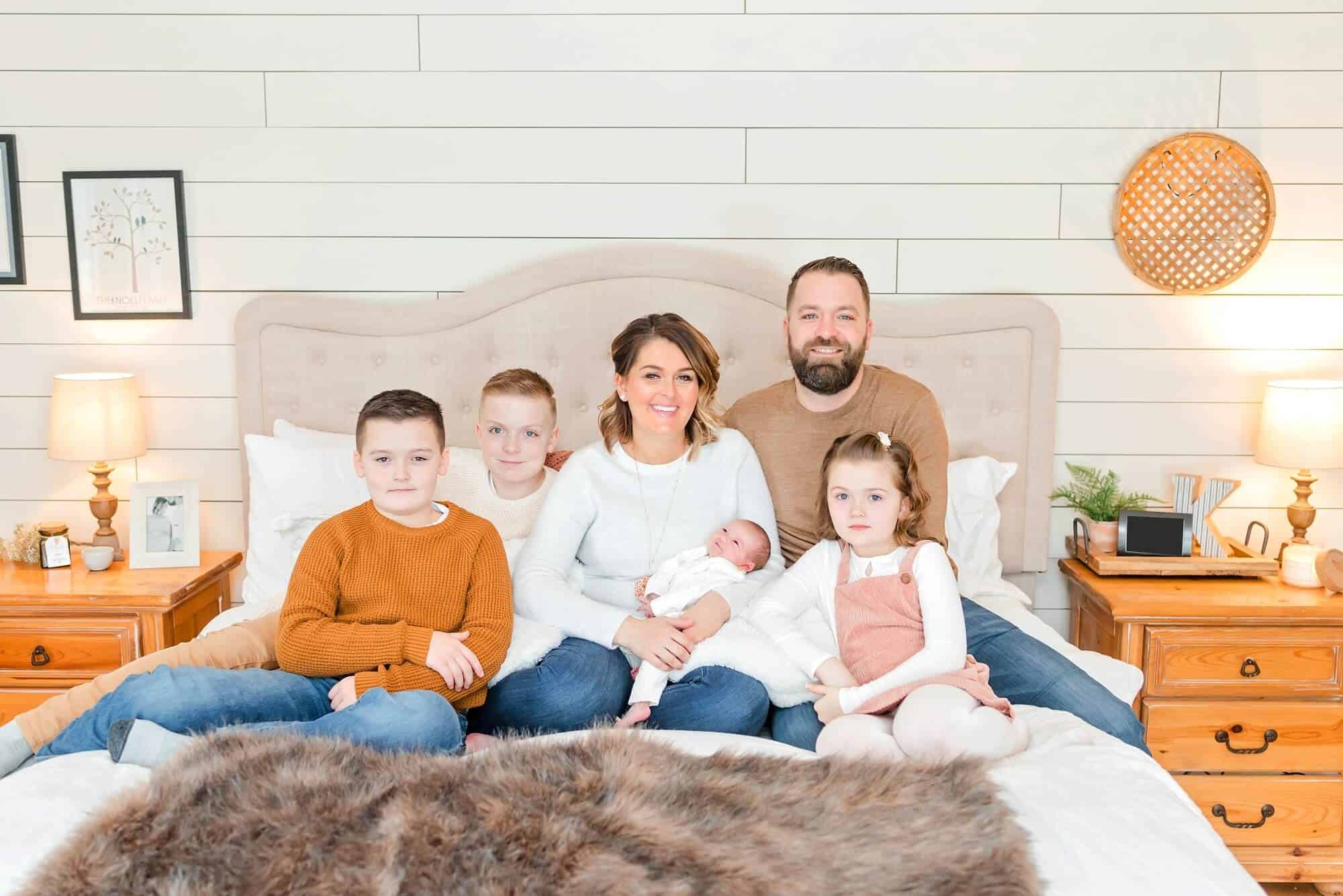 in-home newborn session full family on bed portrait tiffany murray
