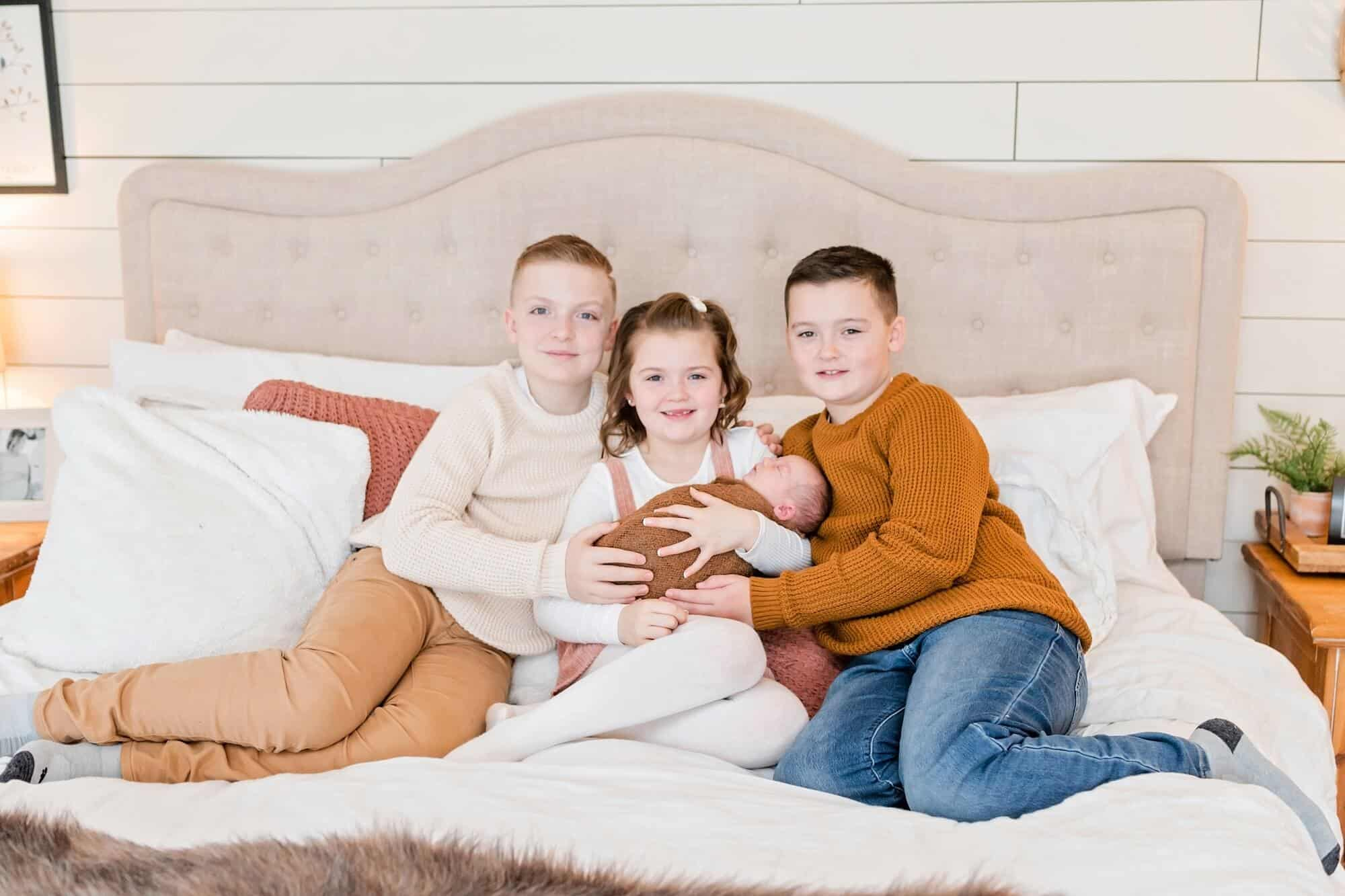 siblings pose in-home newborn session tiffany murray