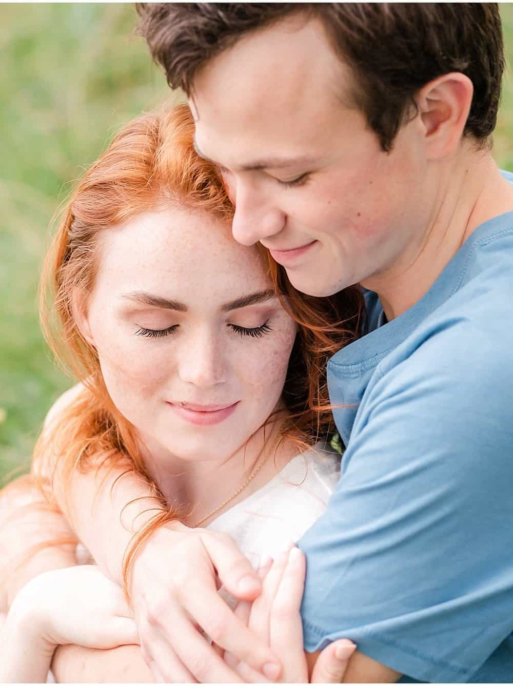 posing in wildflowers sunset engagement session by tiffany murray