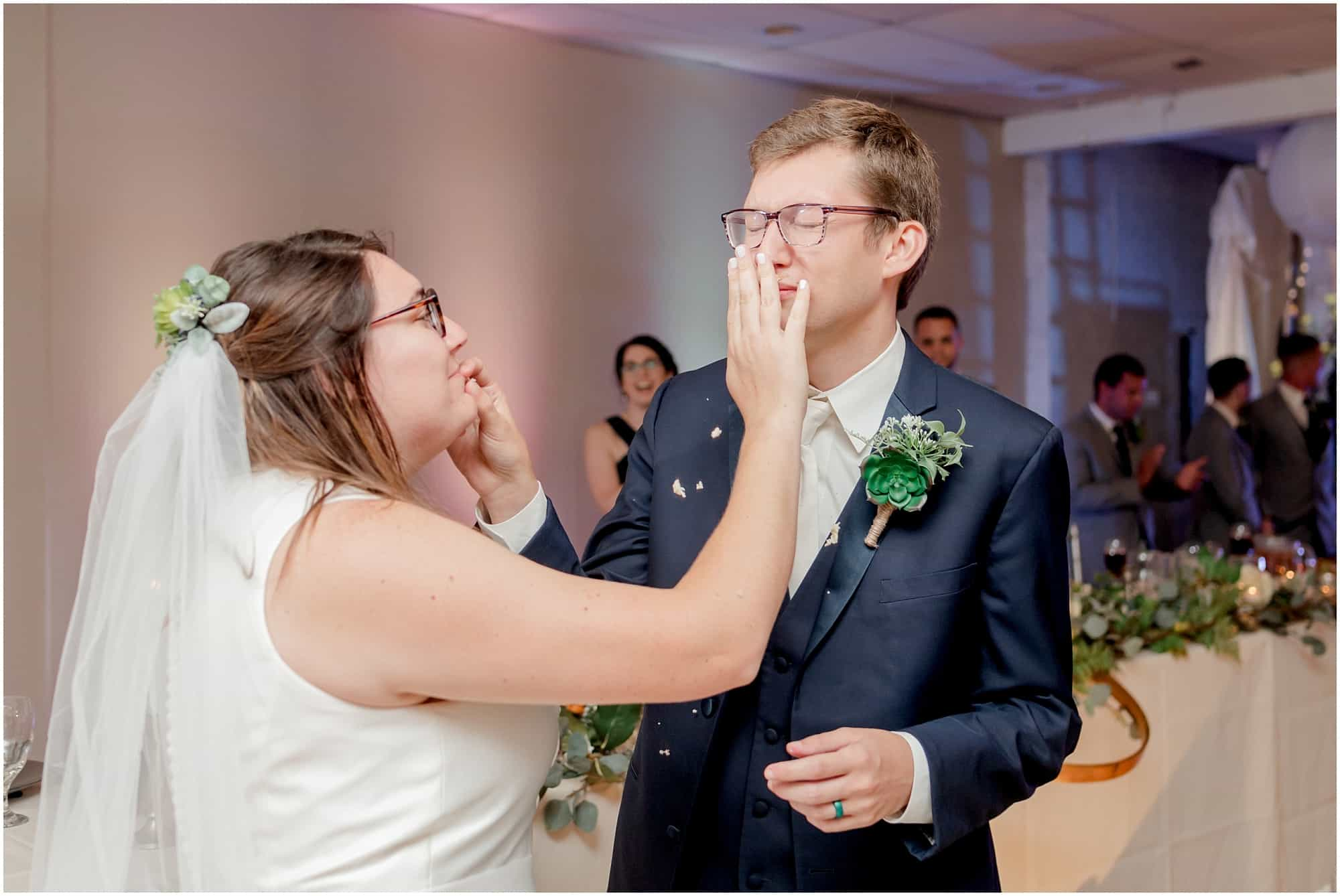 bride smashes cake on groom by tiffany murray