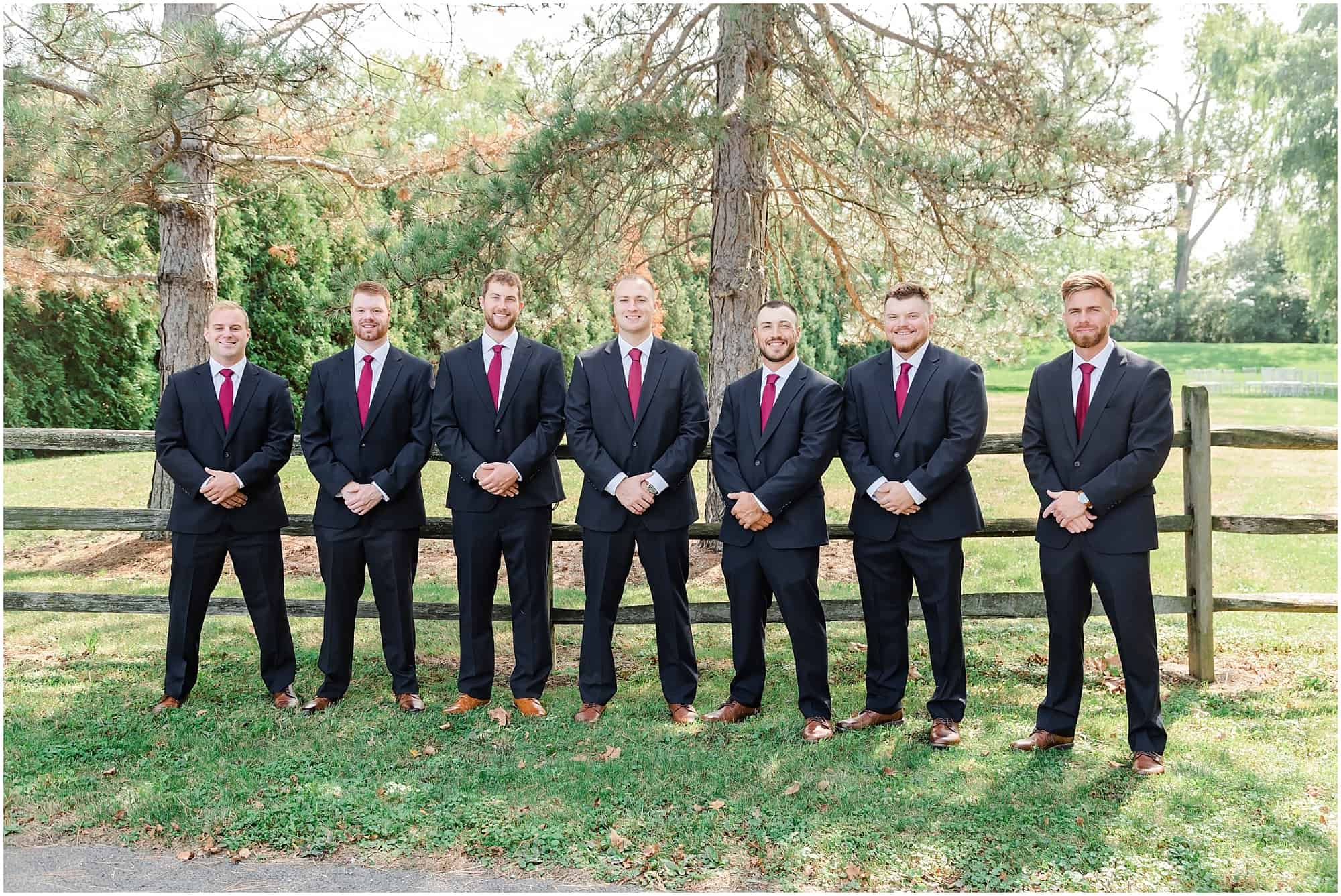 groomsmen pose before ceremony at millsite lodge by tiffany murray