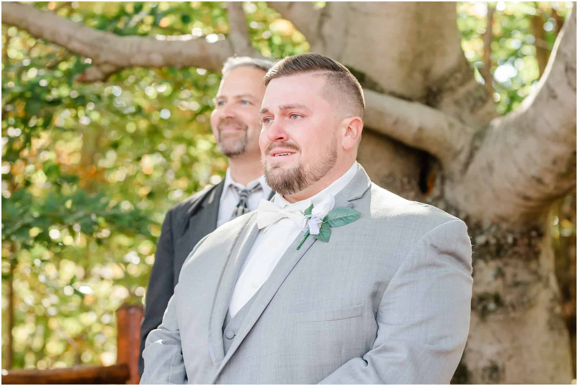 groom reacts to bride walking down the aisle