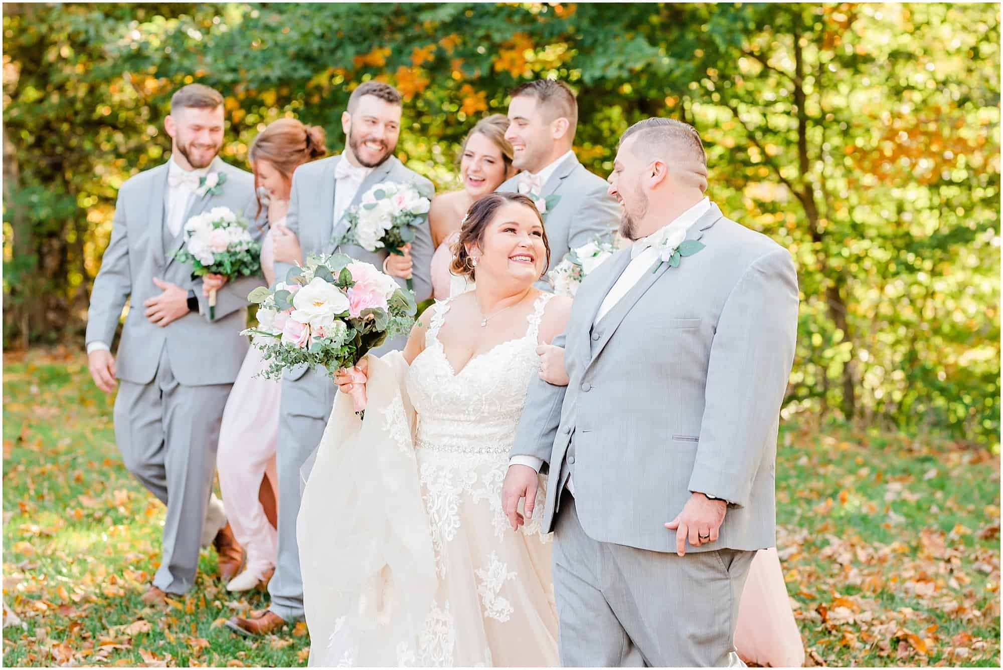 bride and groom walk with bridal party