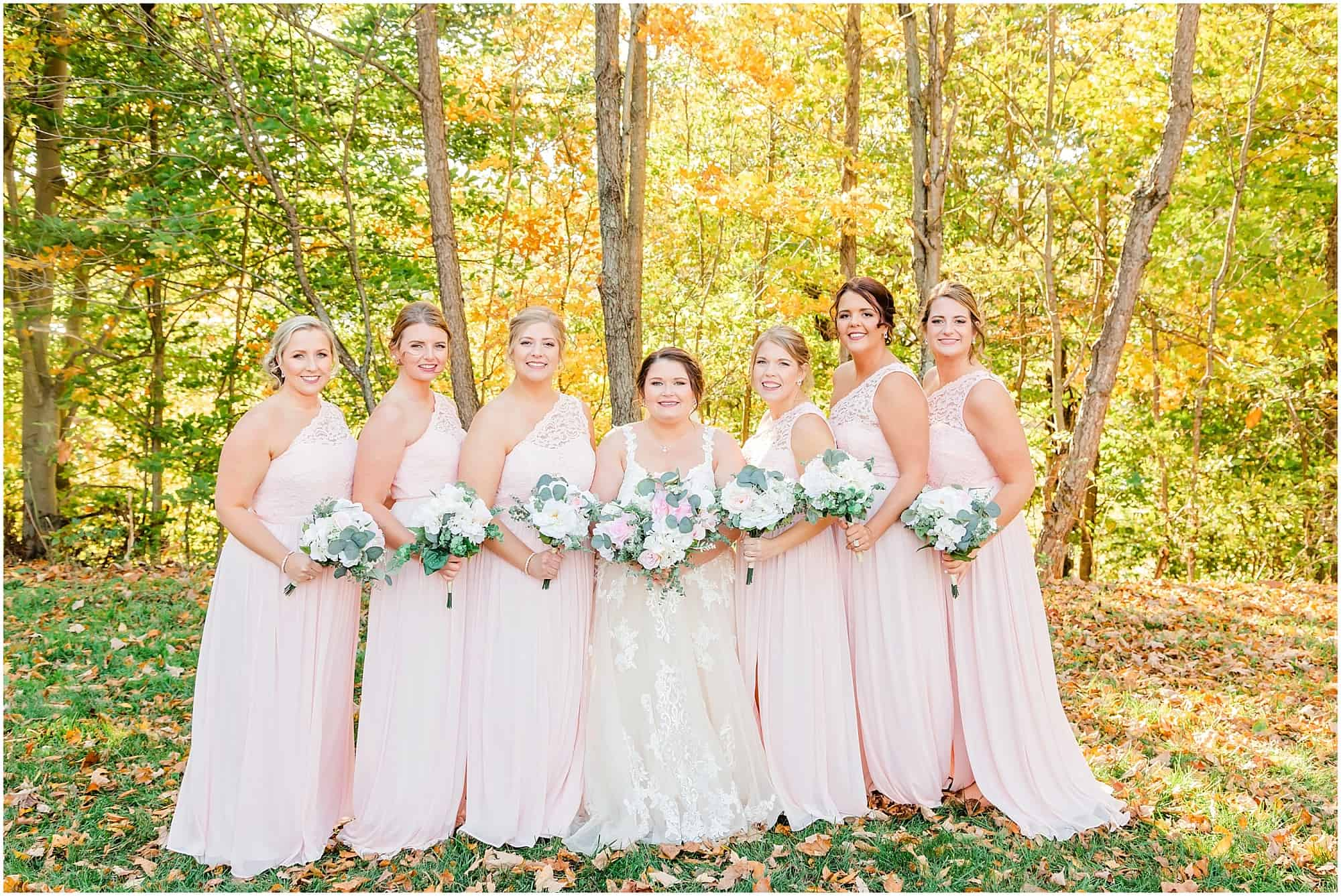 bride and bridesmaids pose