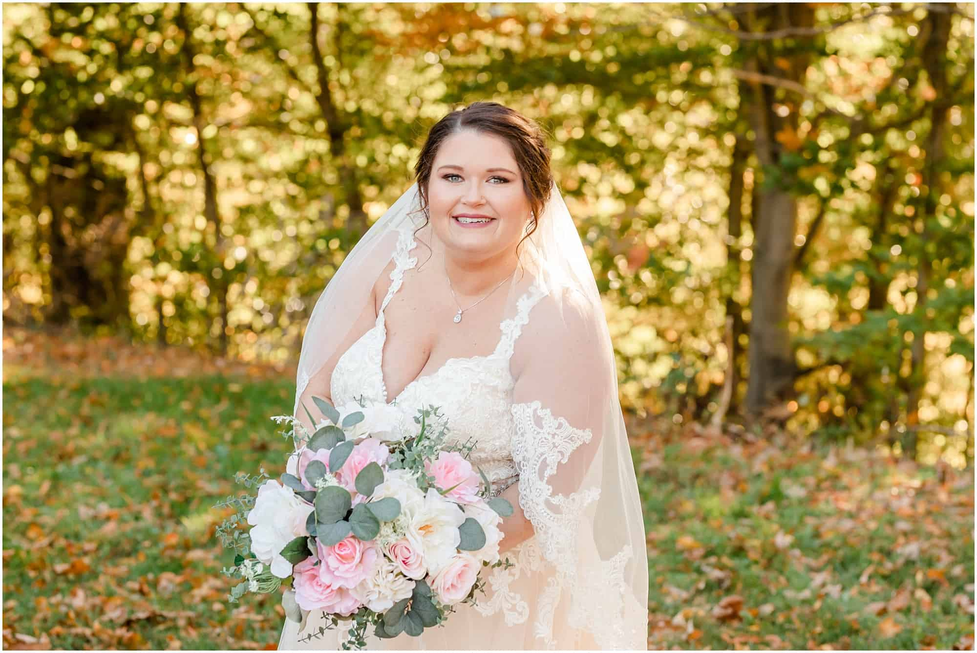 bride poses at fall wedding