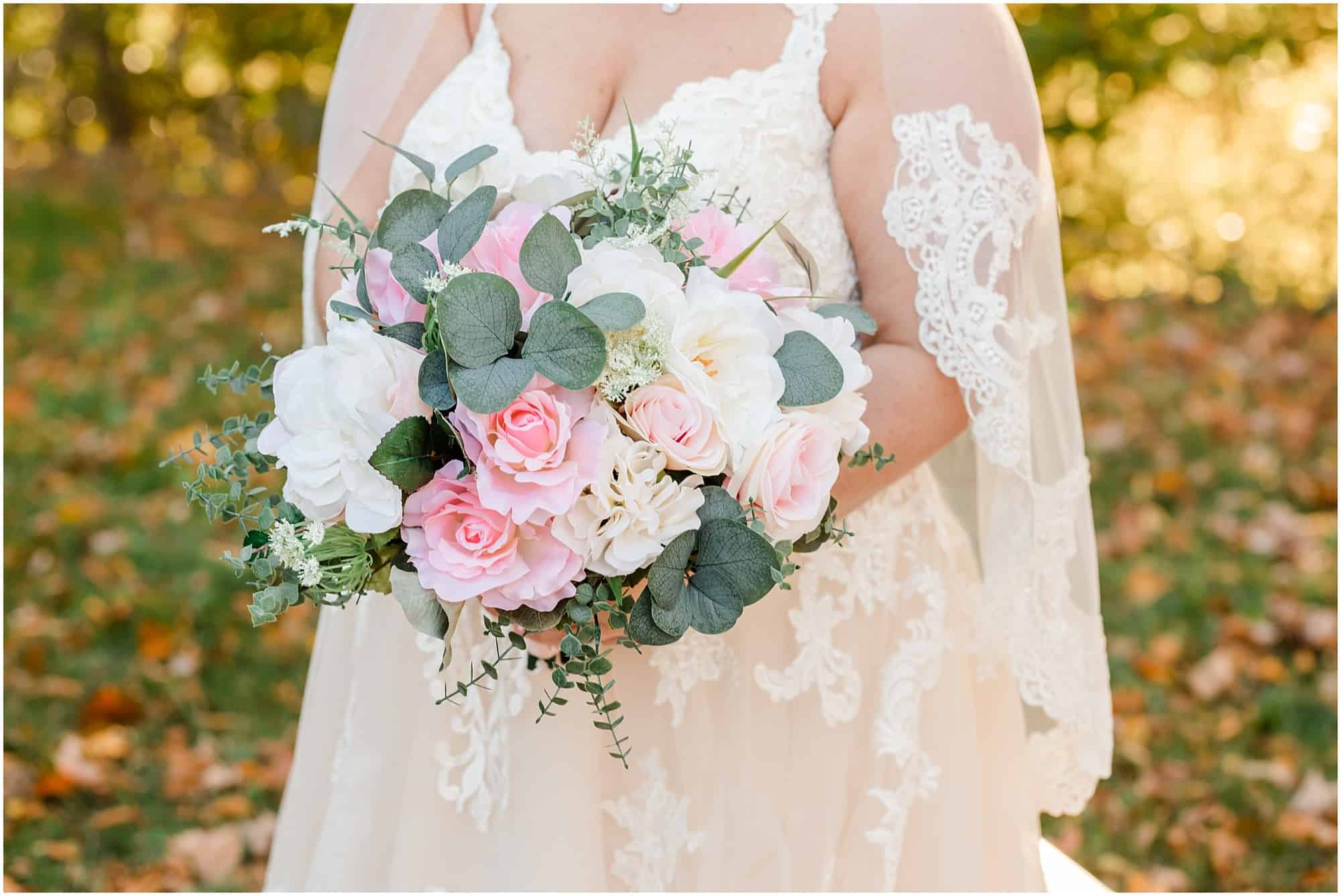 bridal bouquet and dress details
