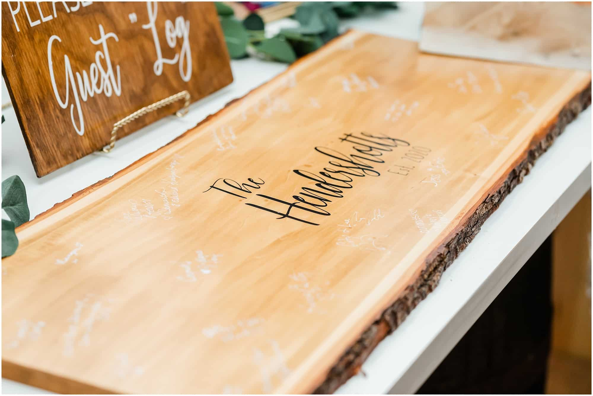 guests sign log at reception