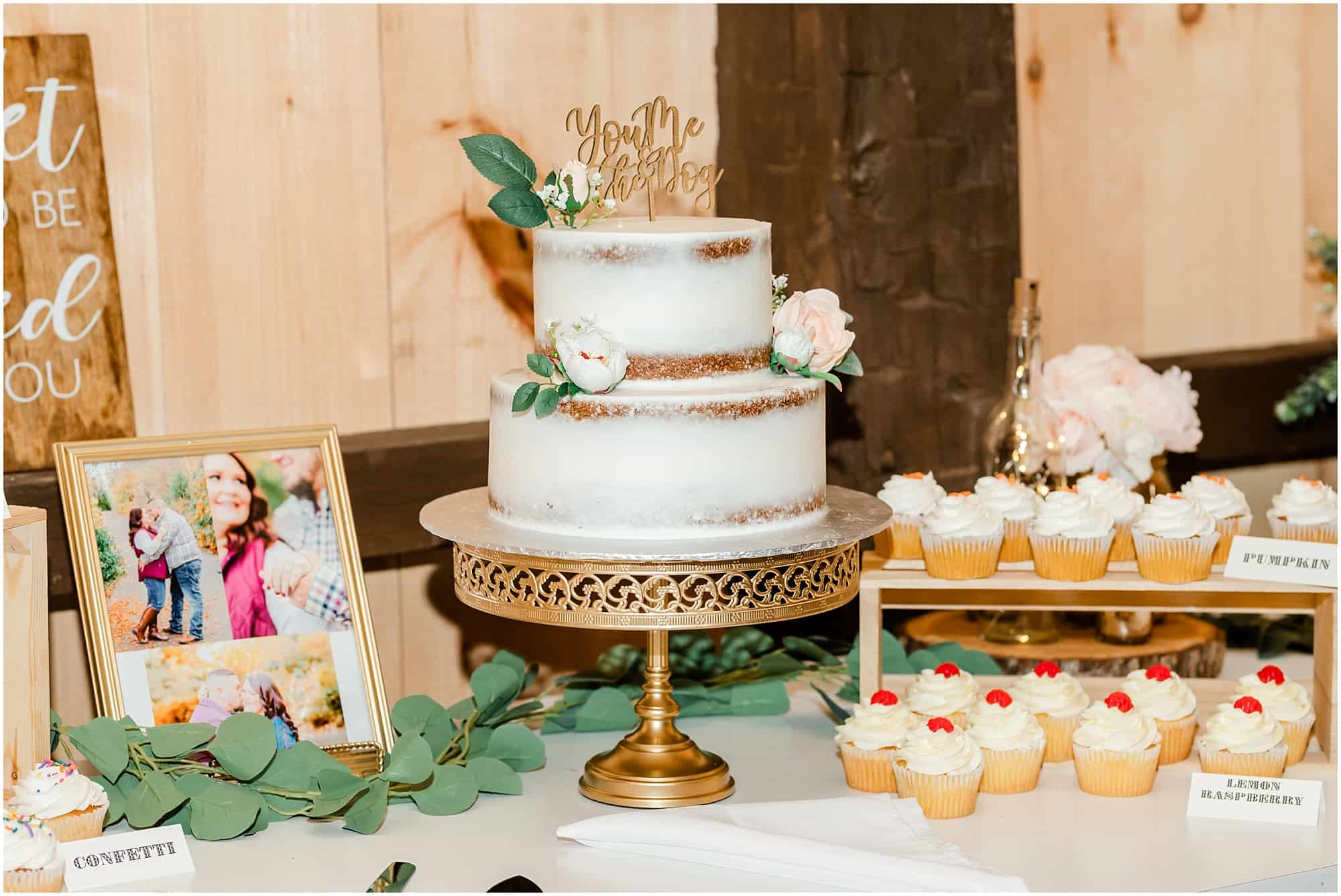 cake and cupcakes at barn wedding