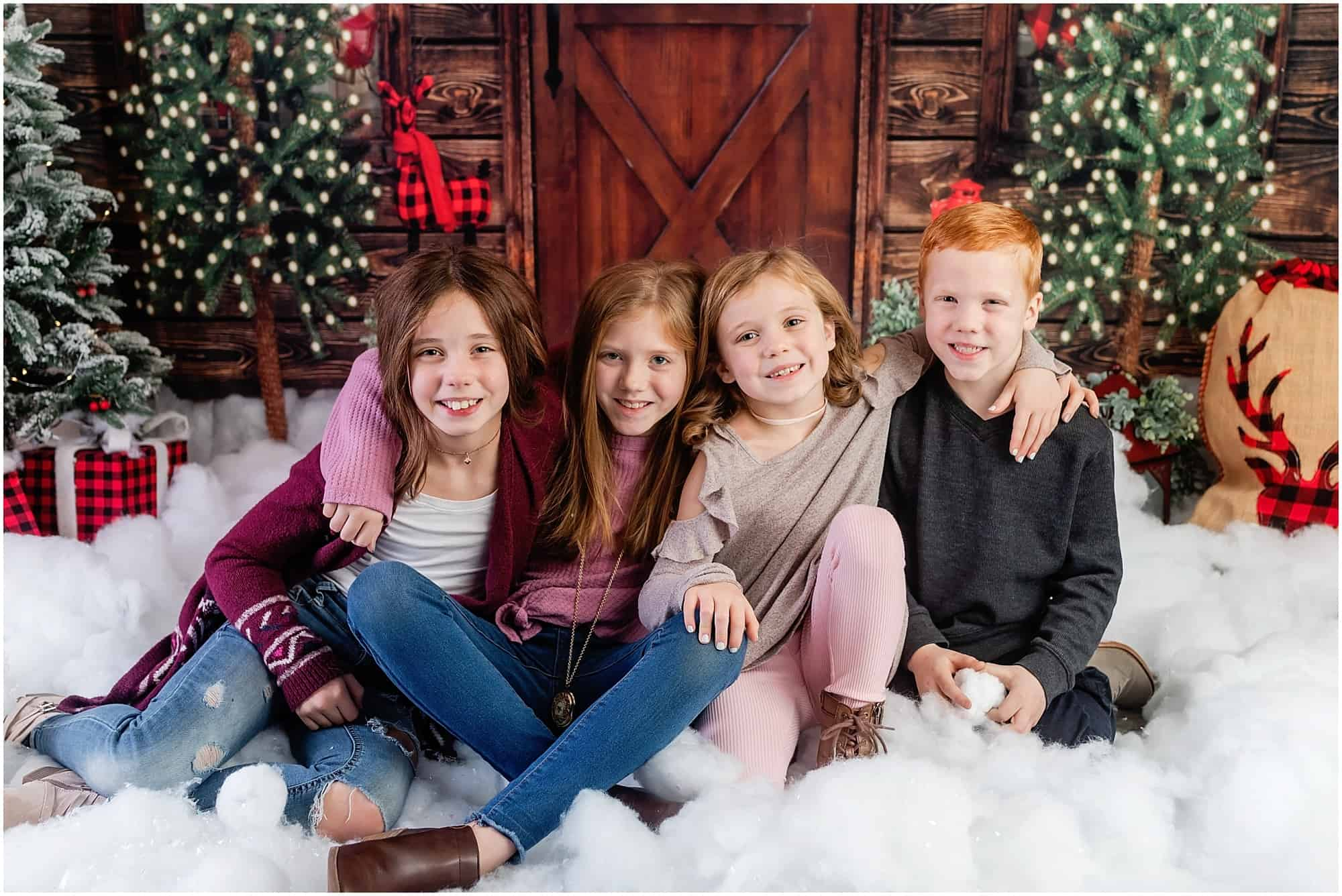siblings christmas portrait in studio