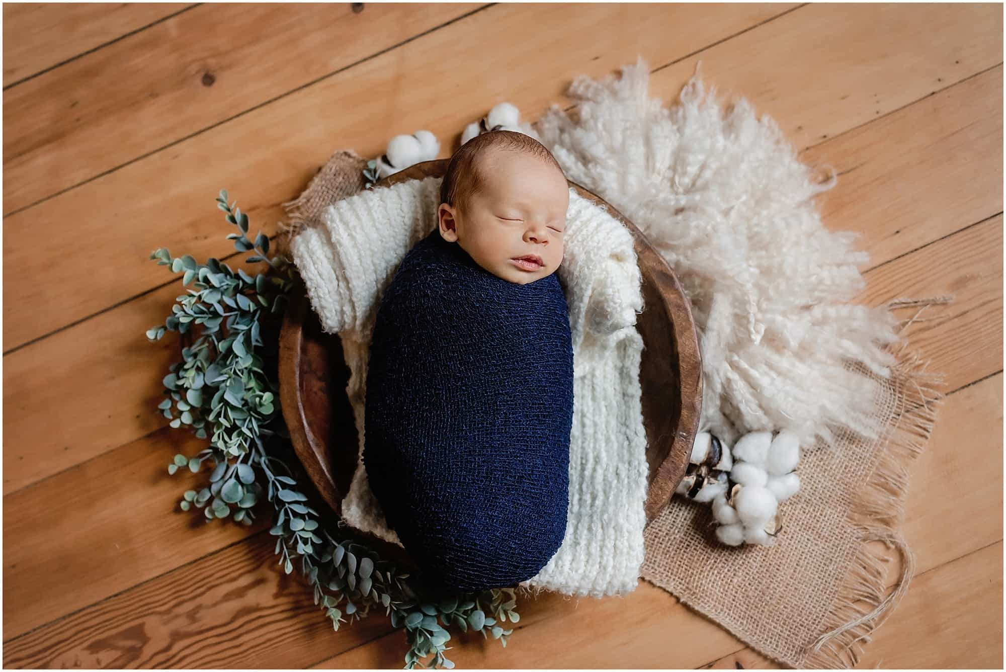 wrapped newborn with cotton and eucalyptus