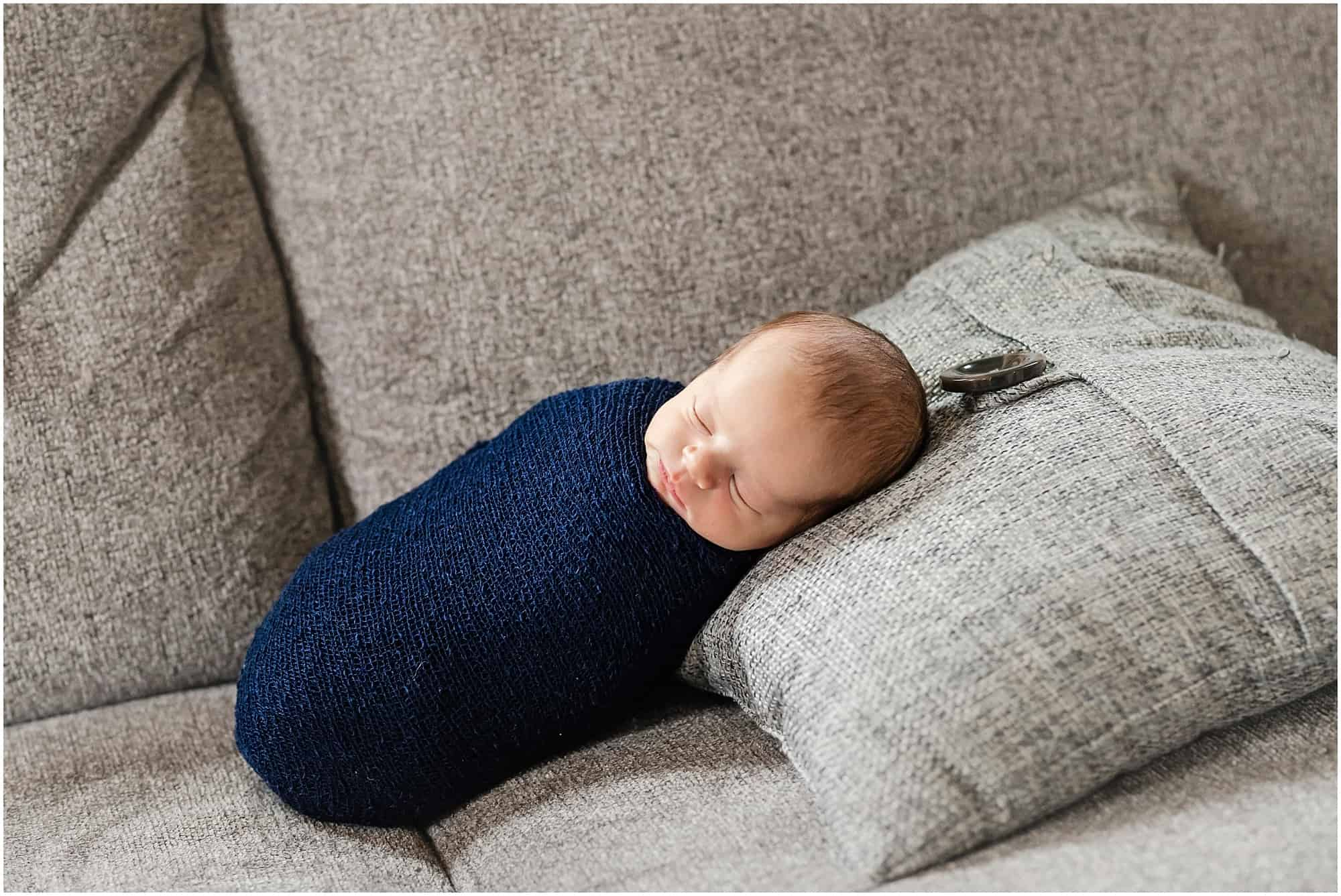 wrapped newborn on couch
